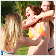 Playing volleyball – Lexxi vs Renee and Blanca