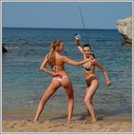 Bikini fencing duel on the beach – Renee vs Maya