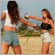 Fencing duel in field – Tess vs Sabrina